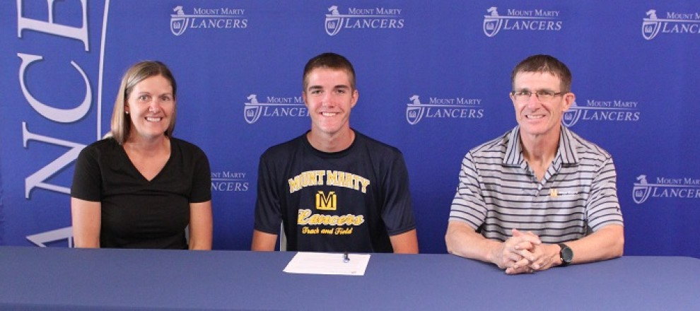 Ives along with mother Debbie Ives and Coach Fischer signs to be a Lancer